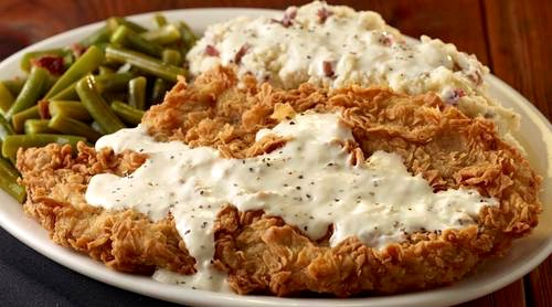 ... -fried steak with gravy, sides of mashed potatoes and green beans